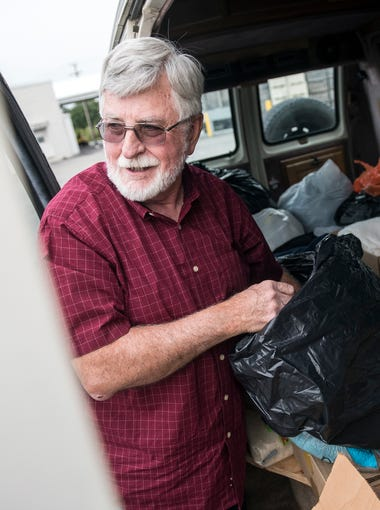Reverend Roddy Runyan grabs prepackaged toiletry bags for migrant workers at Kimes Cider Mill, Monday, August 28, 2017. Fruitbelt Farmworker Christian Ministry provides items to migrant workers, from sweatshirts to toiletries to bibles. Reverend Roddy Runyan has been making rounds to help migrant workers since 1990.