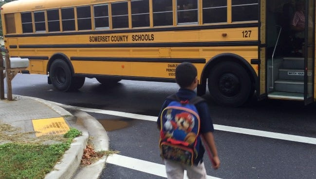 Isaiah, 7, boards a bus in Somerset County.
