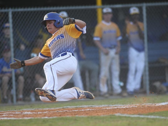 Rickards' Clayton Harley flies through the air while sliding safely into home during a 6-3 win over Florida High on Tuesday night.