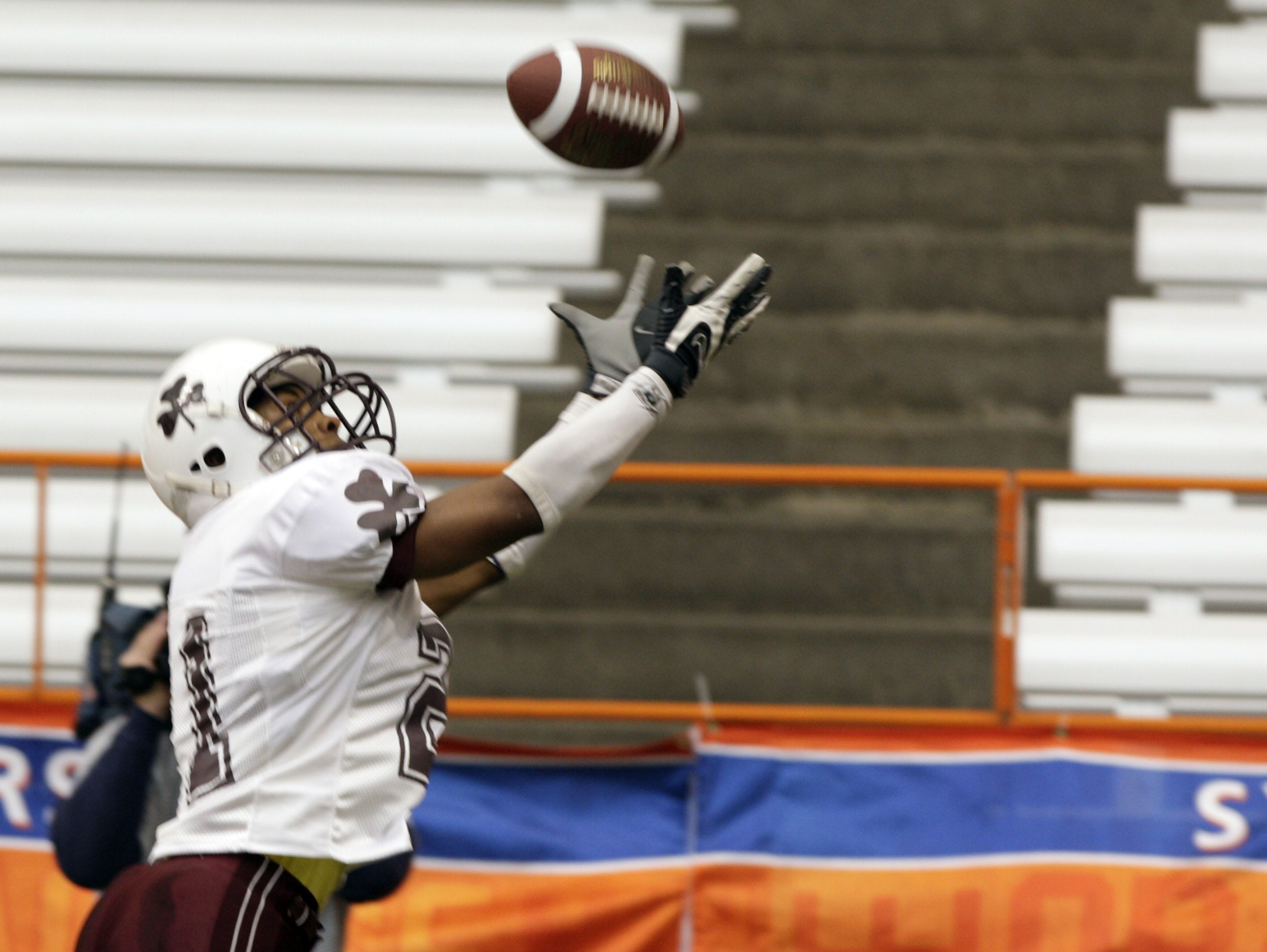 Aquinas' Dwayne Smith tries to reel in an interception during the 2007 Class A state title game between Aquinas and Lansingburgh at the Carrier Dome in Syracuse.