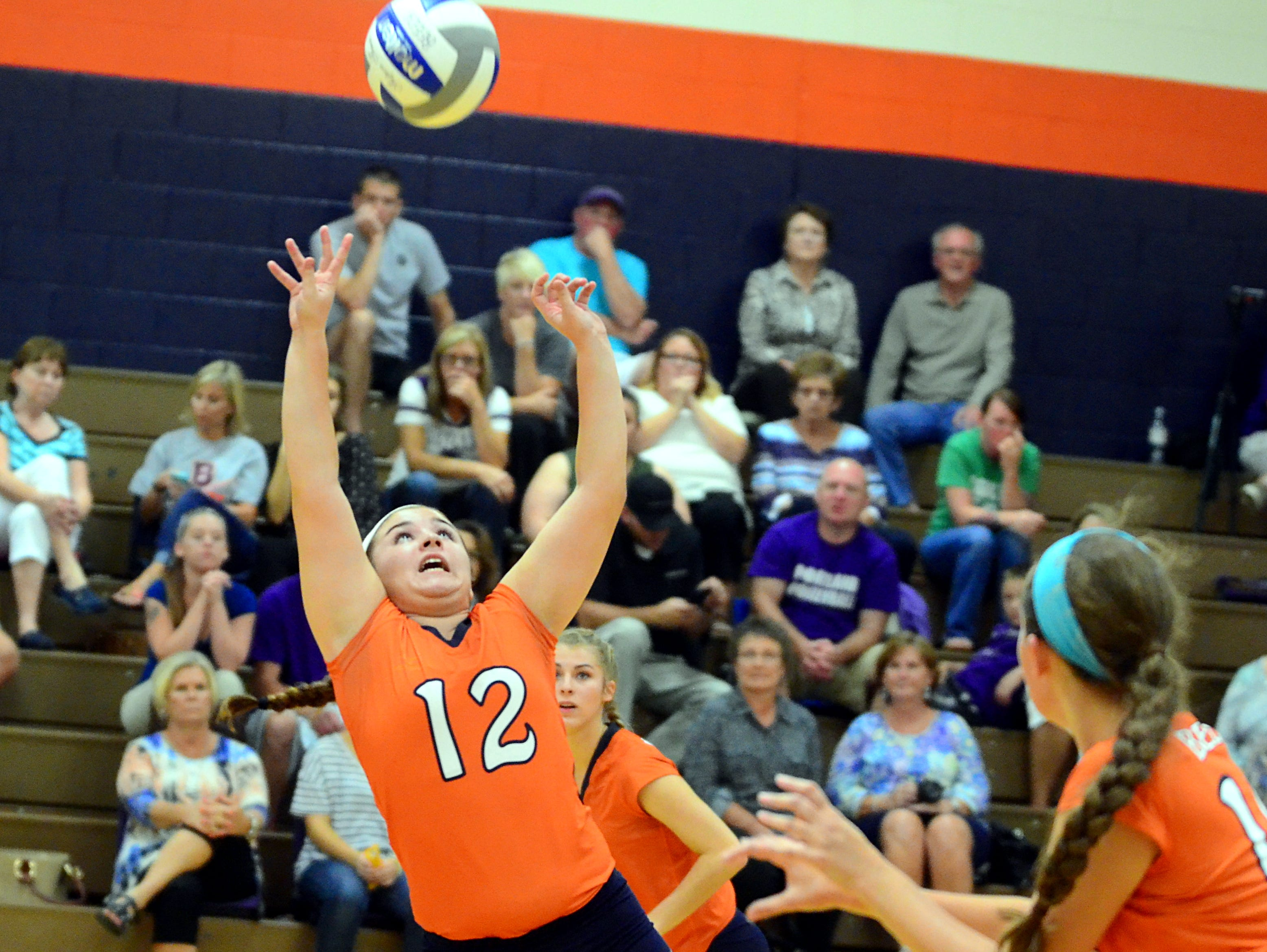 Beech senior Reeves Parrish controls a set as she falls during Tuesday's match against Portland. The Lady Buccaneers won in five sets.