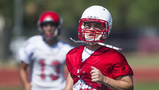 Chaparral High School strong safety Kurt Shughart, right, runs during practice, Saturday, August 8, 2015.