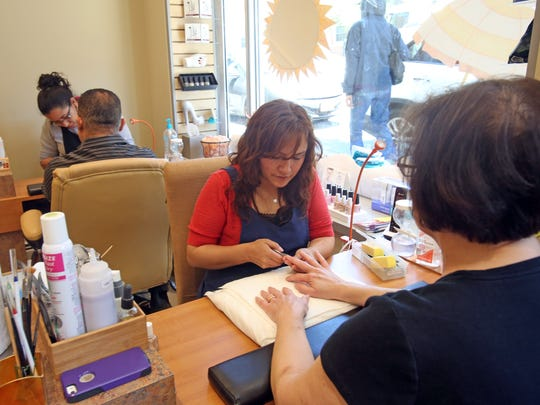 Mely Guaman, a longtime employee of Riverwaves Salon