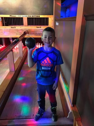 Max Kubiak, 8, of Racine, threw 12 strikes in a row and became the youngest person to score a perfect 300 game in duckpin bowling at The Thirsty Duck in Wauwatosa.