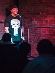 In this 2013 file photo, comedian Tom Garland hosts the Catacombs of Comedy at the Iowa City Yacht Club.