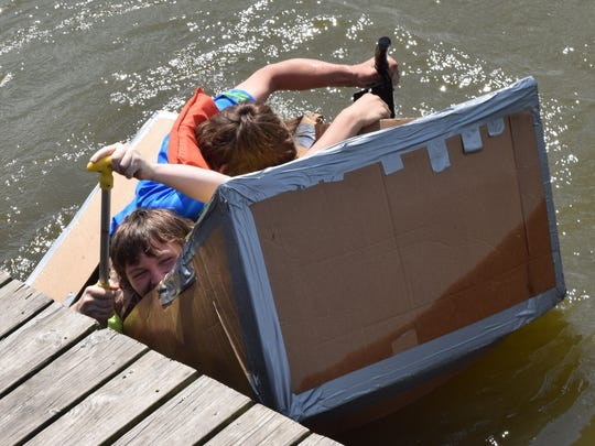 Principles of engineering students from Tioga High School built canoes made out of cardboard and duct tape. The canoes had to be seven feet long and three feet wide - enough to fit through a classroom door. Four teams consisting of four students each held a race at Lake Buhlow in Pineville on Tuesday to test their canoes' seaworthiness. One canoe sank at the starting line.