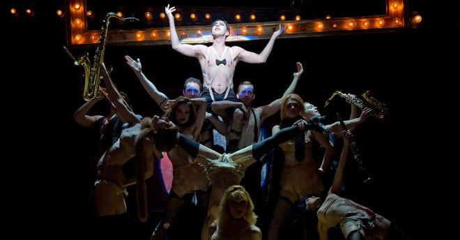 "Alan Cumming, center, leads the Kit Kat Girls and Boys in ""Cabaret."""