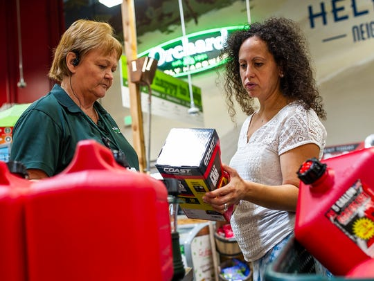 Pamela Cunningham, right, checks out hurricane prep