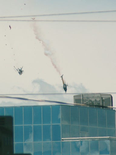 Two TV news helicopters fall to the ground after colliding in downtown Phoenix on Friday, July 27, 2007.