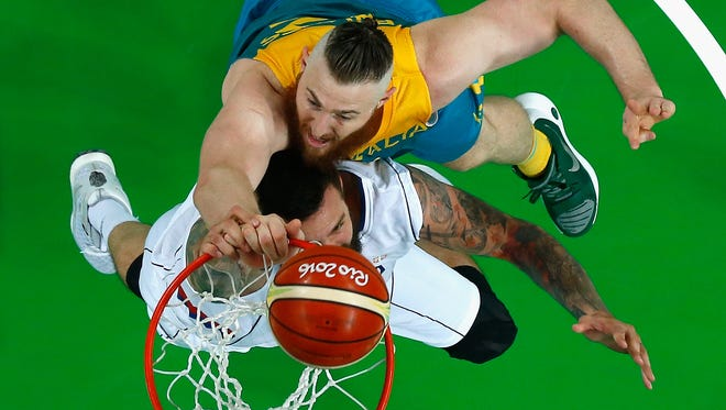 Australia's Aron Baynes (Pistons), back, has the size to give Team USA some problems inside.