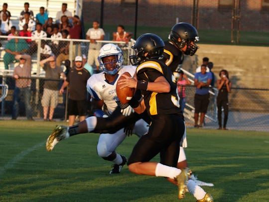 Trenton Peabody's Cooper Baugus (3) looks for a receiver against Chester County during a scrimmage on Friday.