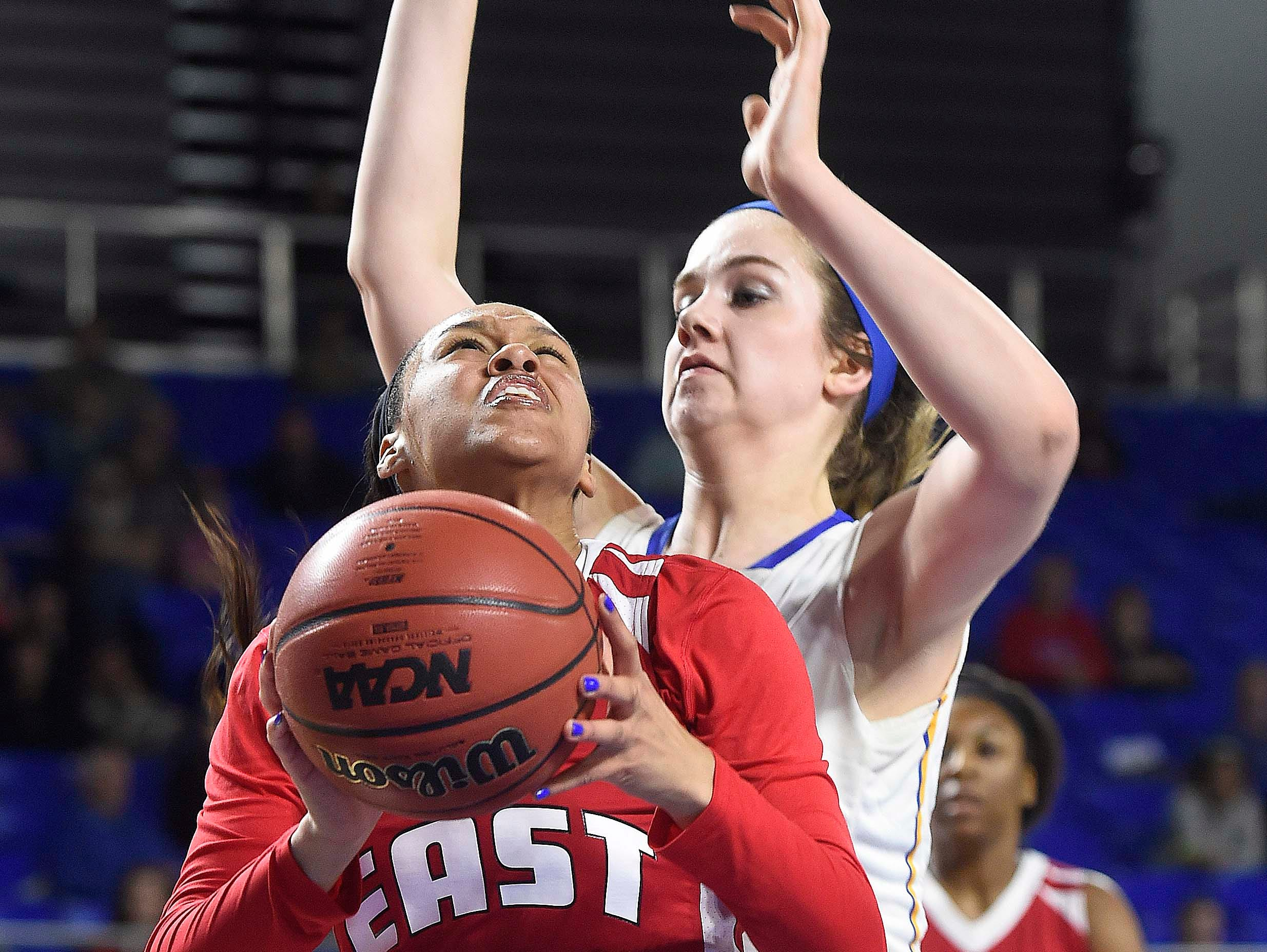 East's Kaia Upton (14) works the paint as her defended Westview's Lydia Pritchett (35) as Westview High School leads 17-13 East Nashville at the half in the Division I Class AA Girl's basketball semi-finals at the Murphy Center on MTSU's campus March 11, 2016 in Murfreesboro, Tenn.