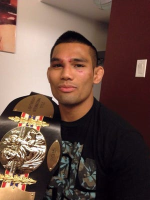 Thai boxing fighter Joe Gogo absorbed a few blows on his way to defeating Sheldon Gaines to win the World Championship Muay Thai North American lightweight championship at Estadio Caliente in Tijuana, Mexico on Saturday, July 18, 2015.