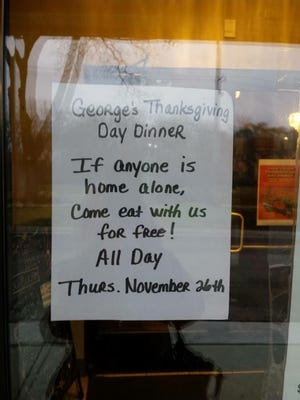 A sign outside George's Senate Coney Island Restaurant in Northville, Mich., invites those alone for Thanksgiving to come have a free meal.