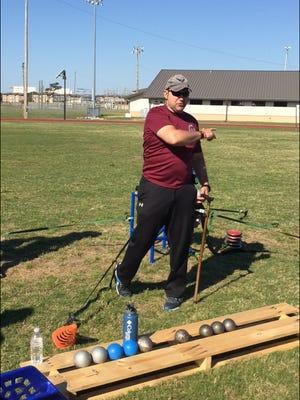 Damian Orslene teaches shot put at Eglin Air Force Base