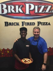 Brandley Tanelus, left, developed a Blue Zones inspired pizza for his employer BRK Pizza, and boss, Randy Trombino.