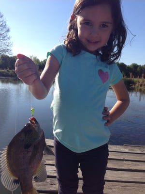 Avery Snoddy, 6, shows off her catch at the family pond. With one hand on her hip and the other with a fish on a line, she's a true Louisiana girl. Send your Cane Pole Memory photo or video to lguidry@gannett.com or post them to The Daily Advertiser Facebook page. Include your name (first and last), age you are in the picture or the approximate year, and where you are in the state. Then tell us your memory. On Dec. 9 we'll randomly draw a winner from the submissions for a gift card to a sporting goods store.