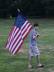 Kyle Jones of Bloomfield waving an American flag at