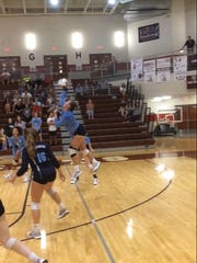 Mandy Prescott jumps up to slam a pass from a teammate