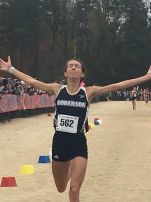Elise Wright captured the individual championship in the 3A Women's Cross Country State Championship meet,