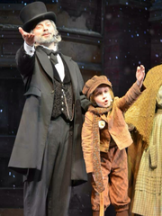 """Carson Spaeny, 12, here shown beside actor Dave Wallace, plays Tiny Tim in Silver Dollar City's production of """"A Christmas Carol."""" He recently started a fundraiser to help children injured in the Nov. 5, 2017 mass shooting at a church in Sutherland Springs, Texas."""