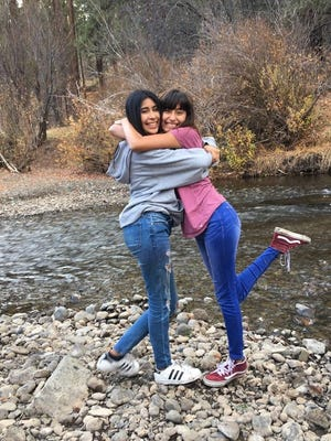 Green Acres middle school student, Alyssa Lino Alcaraz stands with her best friend and sister Mariah. Alyssa died last month from a bacterial infection.