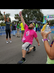 Pensacola's Joey Beckman exults after finishing the Pensacola Marathon in November. (Photo by Megan Cash, special to the News Journal).