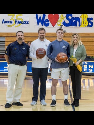 Naples senior Jack Youmans recently was honored for reaching 1,500 points in his career during Senior Night festivities Thursday, Feb. 8, 2018. Pictured from left are: Naples basketball coach Pierre Eaton, Youmans's father Chip, Youmans, and mother Laurie.