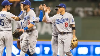 Manny Machado and the Dodgers won two of three games in his first series with them, in Milwaukee.