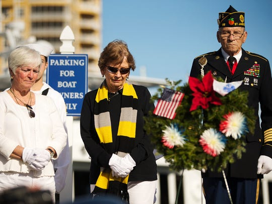 Maureen Kohlhem, left, Maureen Brumbach and U.S. veteran George Bailey honor fallen veterans during a Wreaths Across America ceremony on Saturday at the Tarpon Point Marina in Cape Coral. The national program pays tribute to fallen U.S. military veterans, particularly those who were lost at sea or who were buried at sea. Biodegradable wreaths were placed in tribute in the Gulf of Mexico. The annual event also featured a veteran led motorcycle ride.