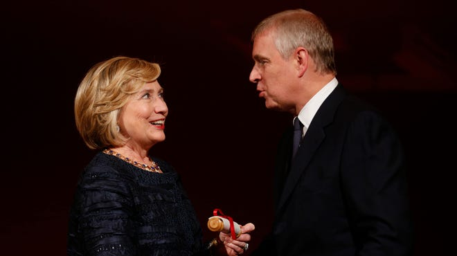 Britain's Prince Andrew talks to former secretary of state Hillary Rodham Clinton as she is presented Oct. 11 with the Chatham House award in recognition of her contribution to the significant improvement of international relations.