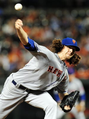 New York Mets pitcher Jacob deGrom throws a pitch in the sixth inning against the Baltimore Orioles