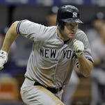 The New York Yankees' Chase Headley runs down the line after hitting an RBI double off Tampa Bay Rays relief pitcher Steven Geltz during the fifth inning Sunday. Alex Rodriguez scored on the hit.