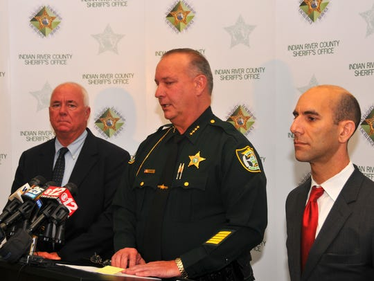 Indian River County Sheriff Deryl Loar, flanked by