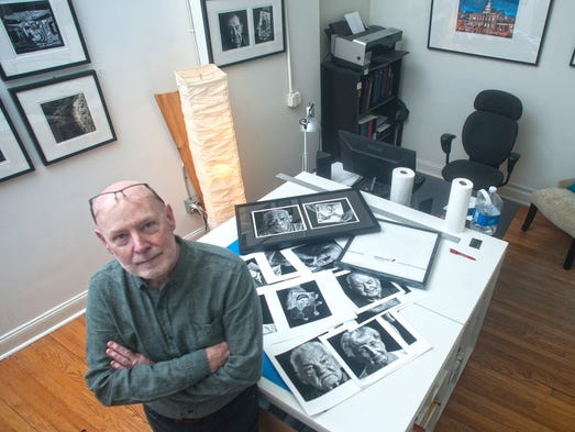 Richard Bell is surrounded by his images at SoHa in