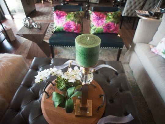 A living room gets its fresh look from green accent colors at Modern Vintage Home in Cherry Hill.