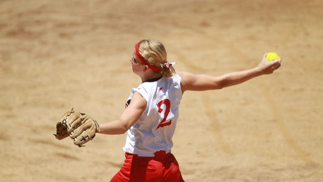 Highland's Katie Springer throws a pitch during the Huskies' game against Waterloo East in 2014. The all-state pitcher returned for this year's campaign, adding to the high expectations.