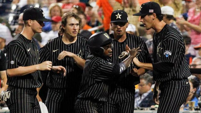 Vanderbilt players celebrate during their 5-1 win over Virginia in game one of the College World Series finals Monday in Omaha, Neb.