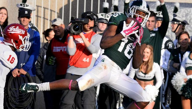 MSU receiver Aaron Burbridge catches the Spartans' third touchdown of the first half past Indiana's Rashard Fant Saturday 10/24/2015.