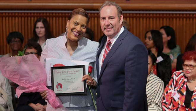 Lesli C. Myers and state Sen. Joe Robach pose for a photo after Myers was recognized with the 2016 Woman of Distinction Award.