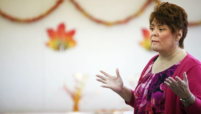 Bettie Hughes, an advocate for consumers navigating the complexities of Medicare, gives a presentation at Berwyn Senior Center in Dearborn on Oct. 13, 2014.