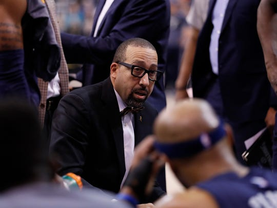 Memphis Grizzlies head coach David Fizdale talks with his players during a first quarter timeout against the Utah Jazz at Vivint Smart Home Arena.