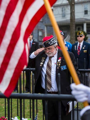 Robert Colby of Veterans of Foreign Wars Post 782 in Burlington salutes after laying a wreath during a ceremony to commemorate Veterans Day at Battery Park in Burlington on Wednesday, November 11, 2015.