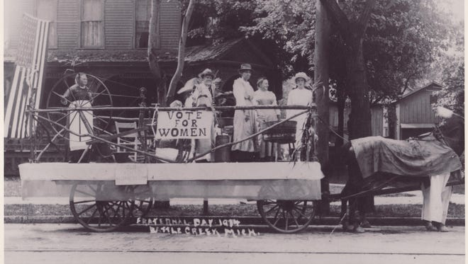 This photo provided by the Michigan Women's Historical Center & Hall of Fame shows a Battle Creek suffrage parade in 1914. Michigan women earned the right to vote in 1918, two years before nationwide enfranchisement.