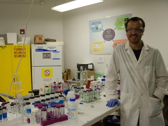 Ali Ozcan, a chemistry Ph.D. student, works for Dr.