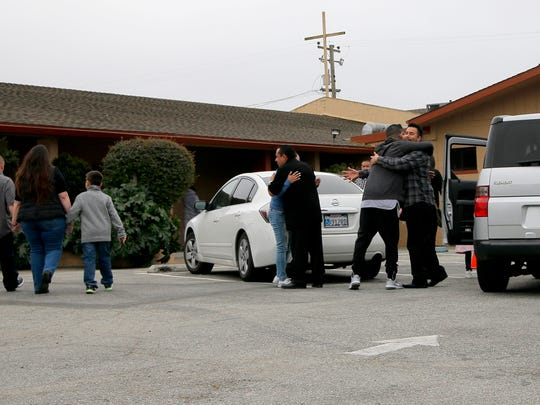 Parishioners embrace as they gather for a service at Victory Outreach Church in Salinas.