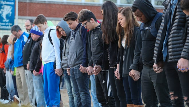 A prayer circle at Paducah Tilghman High School held a prayer circle on Wednesday morning at the school for students at Marshall County High School where two students were killed and 18 others were injured during a shooting on Tuesday morning.