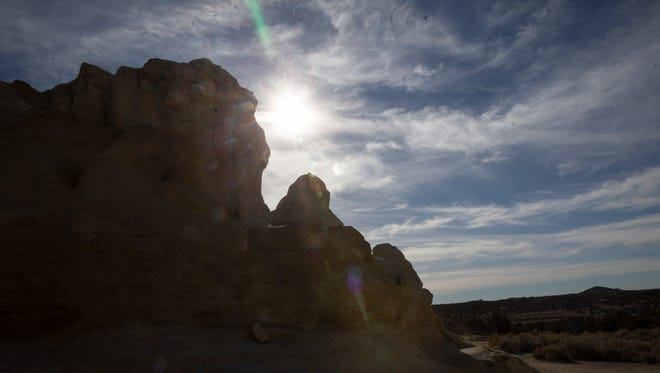 The sun moves across a the Glade Run Recreation Area on Wednesday north of Farmington, which is in a drought because of an unseasonably dry and warm winter.