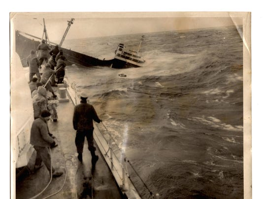 The Fort Mercer sinks as the final two survivors are pulled in via raft. The man standing along the rail, in black is believed to be Kiely.