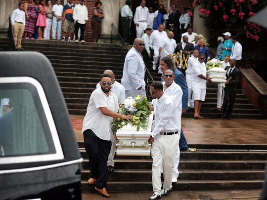 Family and friends of four young stabbing victims carry their caskets out of the Metropolitan Baptist Church on July 9, 2016 after funeral services near LeMoyne-Ownen Saturday. The mother, Shanynthia Gardner, has been accused of killing the four children Ñ 4-year-old Tallen Gardner, 3-year-old Sya Gardner; 2 year-old Sahvi Gardner and six-month-old Yahz.